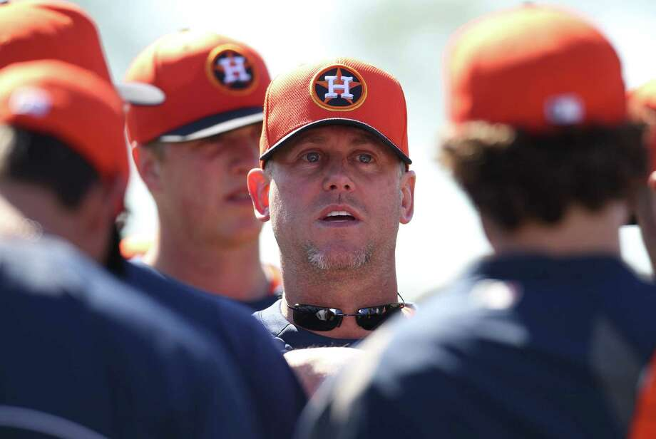 The Astros have heeded the advice of hitting coach John Mallee, center, in spring training to the tune of a .302 team average. Photo: Karen Warren, Staff / © 2013 Houston Chronicle