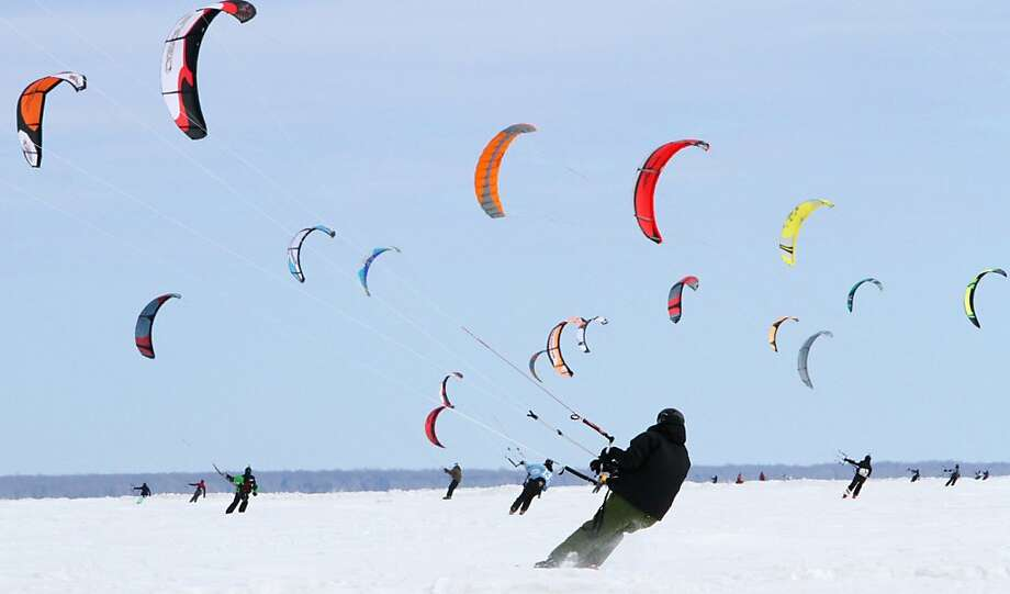 Kite surfers take to the ice Sunday, March 3, 2013 during the ninth annual Kite Crossing event on Mille Lacs Lake in Garrison, Minn.  Photo: Kelly Humphrey, Associated Press