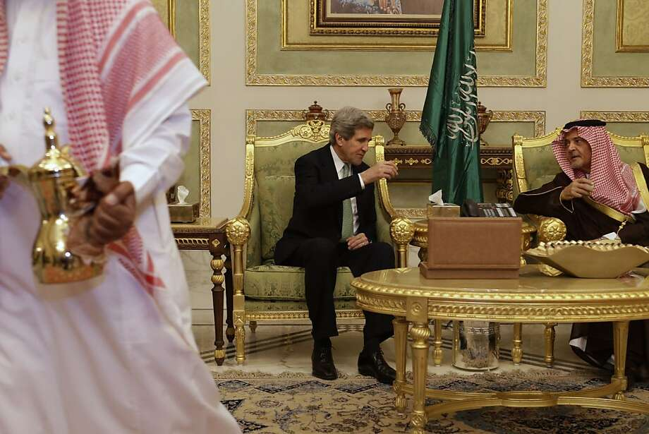 U.S. Secretary of State John Kerry drinks coffee with Saudi Foreign Minister Prince Saud al-Faisal, during a welcoming ceremony on his arrival in Riyadh, Saudi Arabia on Sunday, March 3, 2013. Saudi Arabia is the seventh leg of Kerry's first official overseas trip.  Photo: Jacquelyn Martin, Associated Press