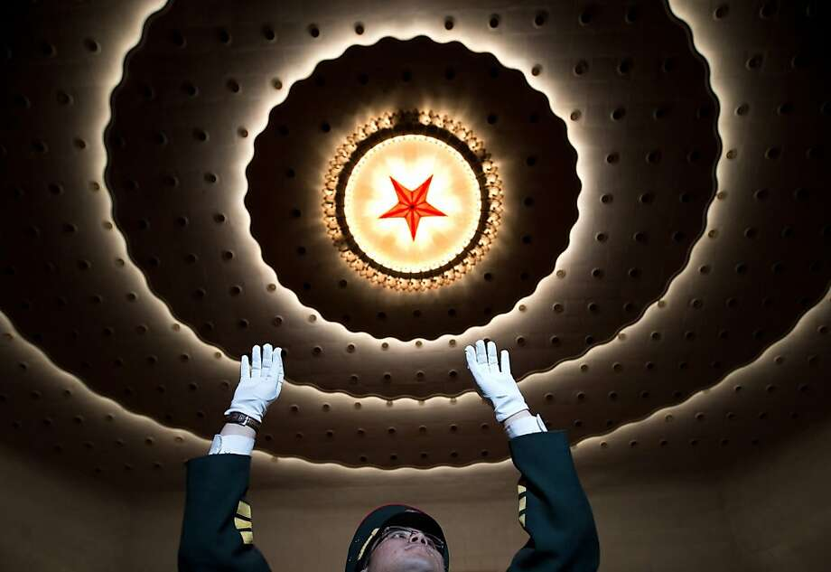 A military band conductor rehearses before the opening session of the Chinese People's Political Consultative Conference in Beijing's Great Hall of the People Sunday, March 3, 2013.  Photo: Andy Wong, Associated Press