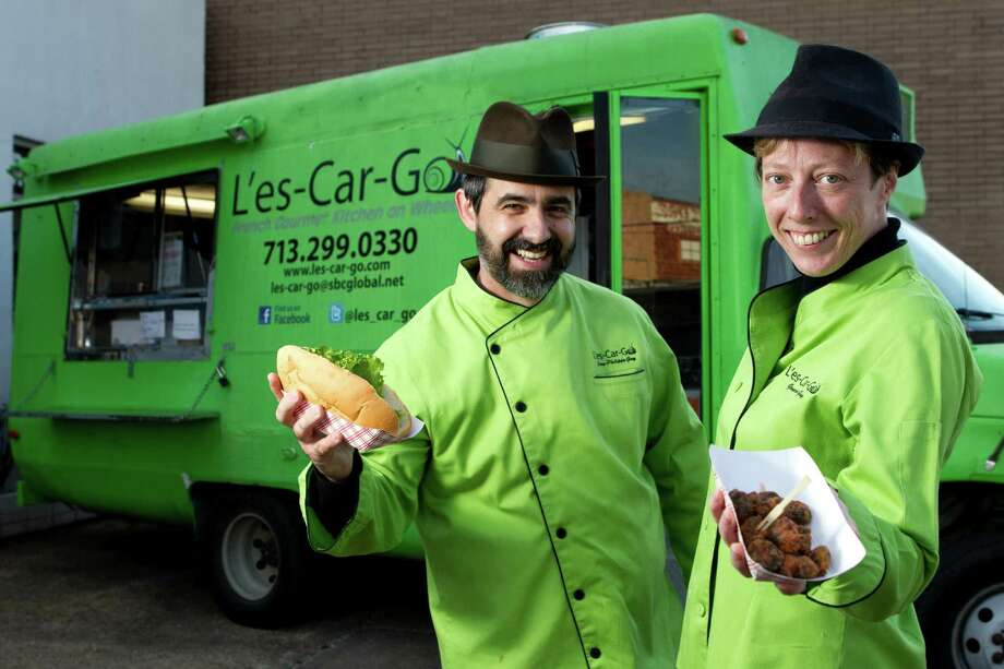 """Houston restaurateurs Jean-Phillipe and Genevieve Guy have seen a spike in the price of Indonesian snails, which are used in their escargot sandwiches and """"poppers"""" on the menu of their L'es-Car-Go food truck. Photo: Brett Coomer, Staff / © 2013 Houston Chronicle"""