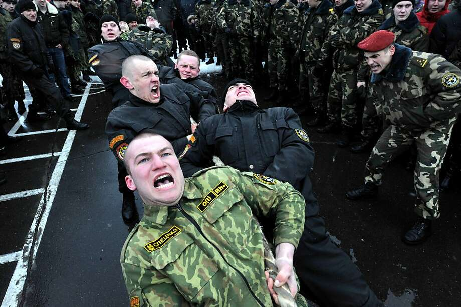 Belarus soldiers from an Interior Ministry special unit compete in a tug-of-war during a military show marking Maslenitsa holiday on the outskirts of Minsk on March 3, 2013. Maslenitsa is an medieval pagan festival that celebrates the end of winter and the start of spring.  Photo: Victor Drachev, AFP/Getty Images