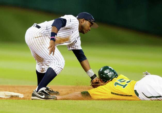 Rice second baseman Leon Byrd (1) tags Baylor's Adam Toth (15) out on an attempted steal during the fourth inning of the  Astros Foundation College Classic at Minute Maid Park on Sunday, March 3, 2013, in Houston. Photo: J. Patric Schneider, For The Chronicle / © 2013 Houston Chronicle
