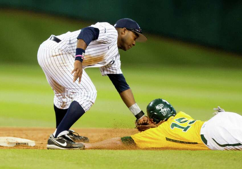 Rice second baseman Leon Byrd (1) tags Baylor's Adam Toth (15) out on an attempted steal during the