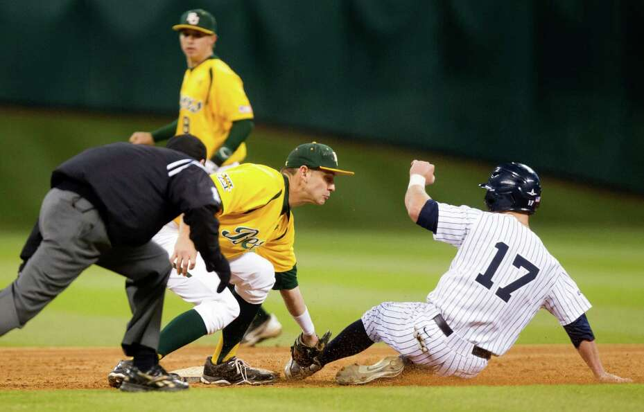 Baylor shortstop Jake Miller (20) tags Rice's Keenan Cook (17) out on an attempted steal during the