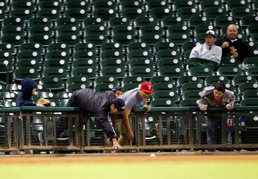 Fans reach for a foul ball during the Astros Foundation College Classic at Minute Maid Park on Sunda