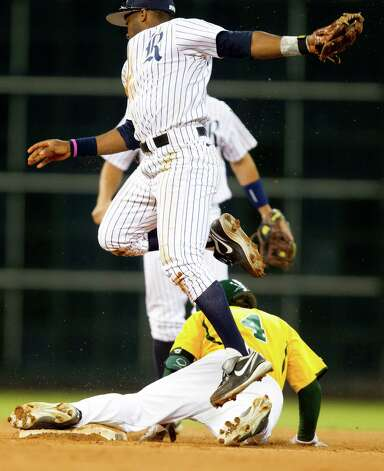 Baylor's Nathan Orf (4) makes it safely to second past Rice second baseman Leon Byrd (1) on an error during the third inning of the Astros Foundation College Classic at Minute Maid Park on Sunday, March 3, 2013, in Houston. Photo: J. Patric Schneider, For The Chronicle / © 2013 Houston Chronicle