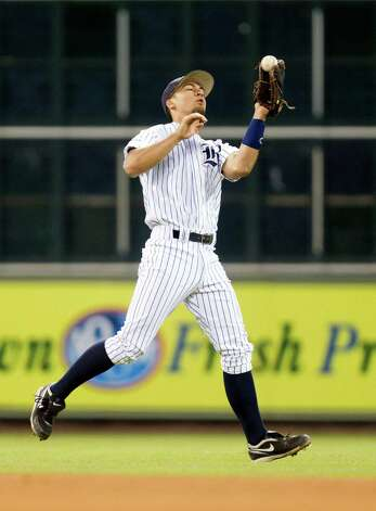 Rice shortstop Ford Stainback (11) brings in a fly ball for an out during the first inning against Baylor at the Astros Foundation College Classic at Minute Maid Park on Sunday, March 3, 2013, in Houston. Photo: J. Patric Schneider, For The Chronicle / © 2013 Houston Chronicle