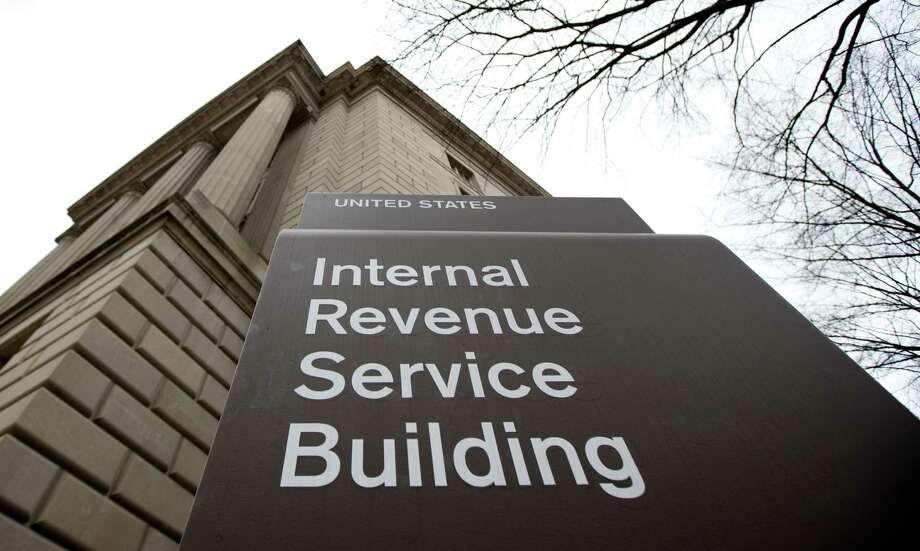 This photo taken March 2, 2013, shows the Internal Revenue Service building at the Federal Triangle complex in Washington, Saturday, March 2, 2013. According to projections by the Tax Policy Center, a research organization based in Washington, wealthy families are paying some of their biggest federal tax bills in decades, even as the rest of the population continues to pay at historically low rates. And a new analysis by the Congressional Budget Office shows that average tax bills for high-income families have rarely been higher since the Congressional Budget Office began tracking the data in 1979, while middle- and low-income families aren't paying as much as they used to. (AP Photo/ roomManuel Balce Ceneta) Photo: Manuel Balce Ceneta
