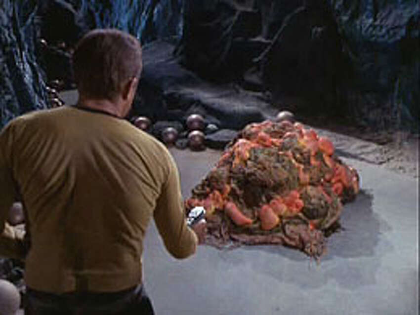 Now for photos of alien life as we have imagined it over the years Capt. Kirk vs. the silicon-based lifeform known as the Horta. One of the more innovative images of alien life ... since at the very least it isn't bipedal like many of the aliens we are prone to envision.
