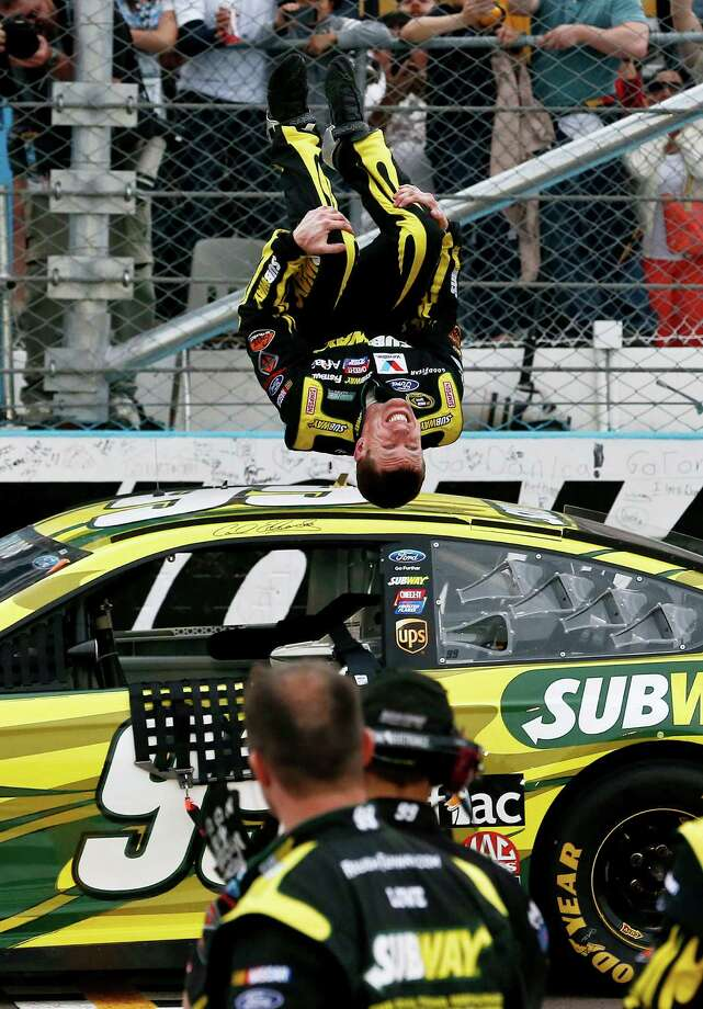 Carl Edwards performs a flip in front of his crew as he celebrates winning the NASCAR Sprint Cup Series auto race, Sunday, March 3, 2013, in Avondale, Ariz. (AP Photo/Ross D. Franklin) Photo: Ross D. Franklin