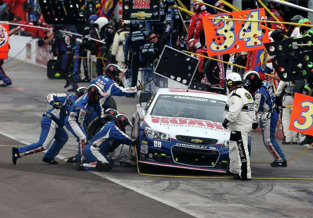 Dale Earnhart Jr., makes a pit stop during the NASCAR Sprint Cup Series auto race, Sunday, March 3, 2013, in Avondale, Ariz. (AP Photo/Matt York) Photo: Matt York