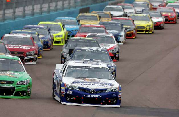 Mark Martin leads the pack at the start of the NASCAR Sprint Cup Series auto race, Sunday, March 3, 2013, in Avondale, Ariz. (AP Photo/Matt York) Photo: Matt York