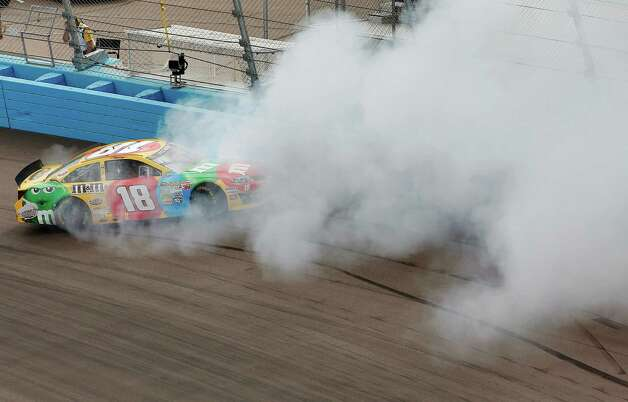 Kyle Busch spins out in Turn 1 during the NASCAR Sprint Cup Series auto race, Sunday, March 3, 2013, in Avondale, Ariz. (AP Photo/Matt York) Photo: Matt York