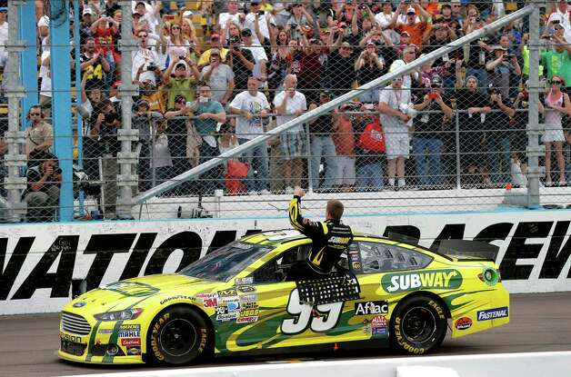 Carl Edwards celebrates winning the NASCAR Sprint Cup Series auto race, Sunday, March 3, 2013, in Avondale, Ariz. (AP Photo/Matt York) Photo: Matt York