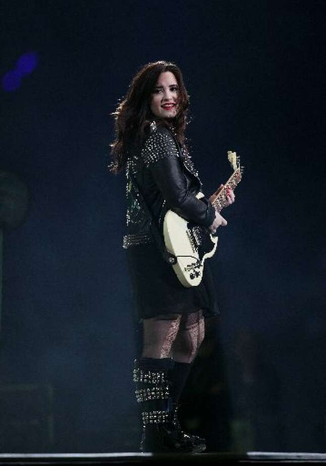 Demi Lovato performs during Houston Livestock Show and Rodeo at Reliant Stadium on Sunday, March 3, 2013, in Houston. ( Mayra Beltran / Houston Chronicle )