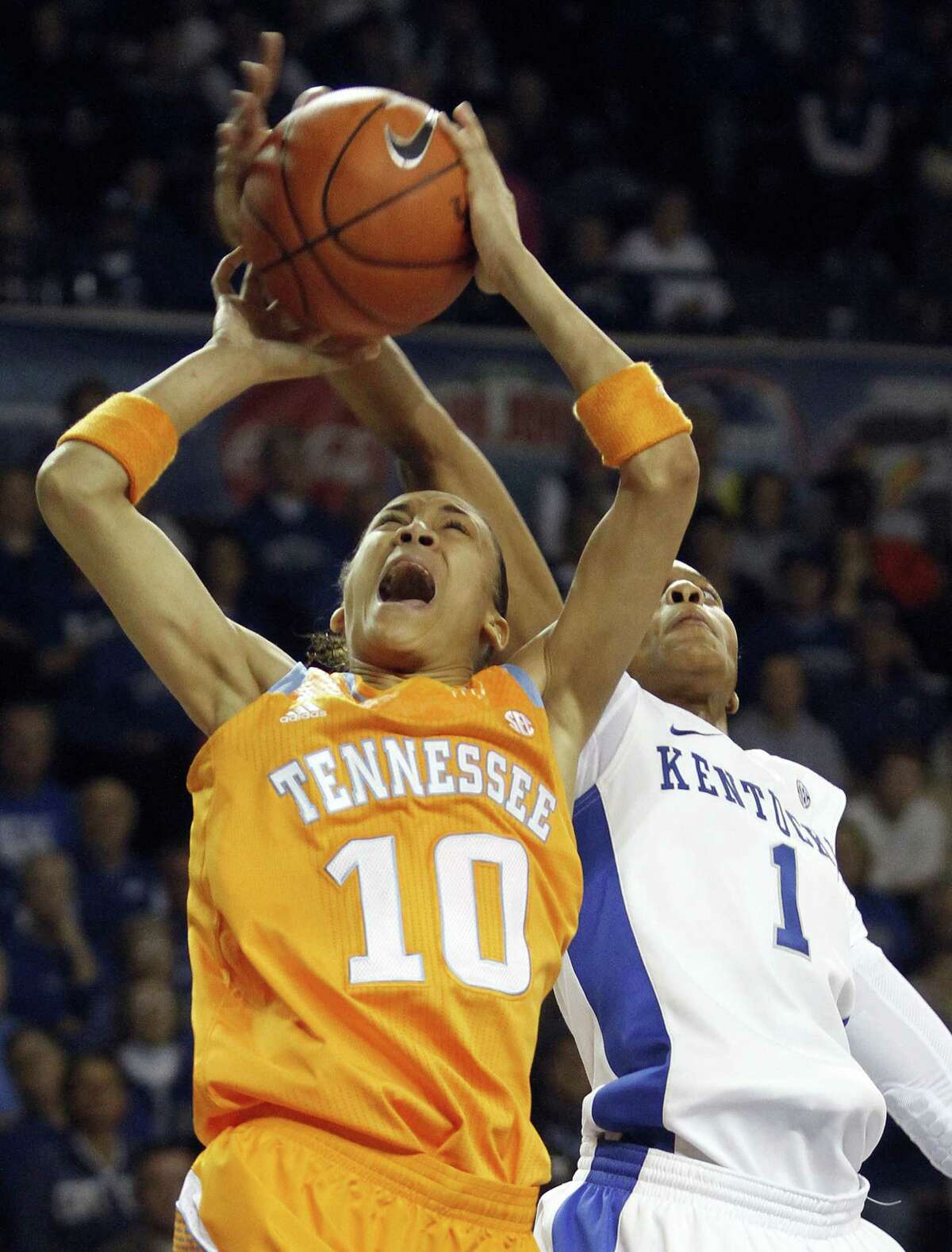 Former Steele standout Meighan Simmons (left), who led Tennessee with 17 points, is rejected by Kentucky's A'dia Mathies in the second half.