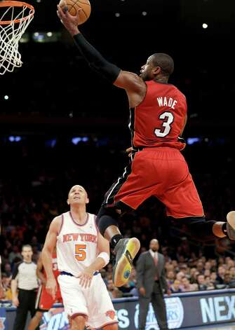Miami Heat guard Dwyane Wade (3) shoots a layup in front of New York Knicks guard Jason Kidd (5) during the second half of their NBA basketball game at Madison Square Garden in New York, Sunday, March 3, 2013. Wade scored 20 points as the Heat won 99-93. (AP Photo/Kathy Willens) Photo: Kathy Willens