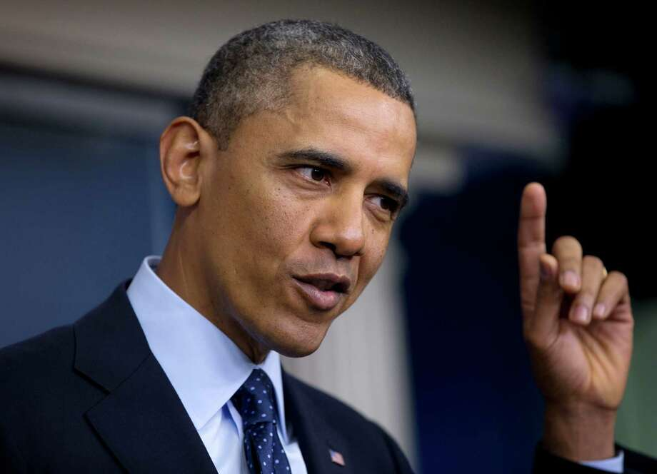 President Barack Obama gestures as he speaks to reporters in the White House briefing room in Washington, Friday, March 1, 2013, following a meeting with congressional leaders regarding the automatic spending cuts. (AP Photo/Carolyn Kaster) Photo: Carolyn Kaster