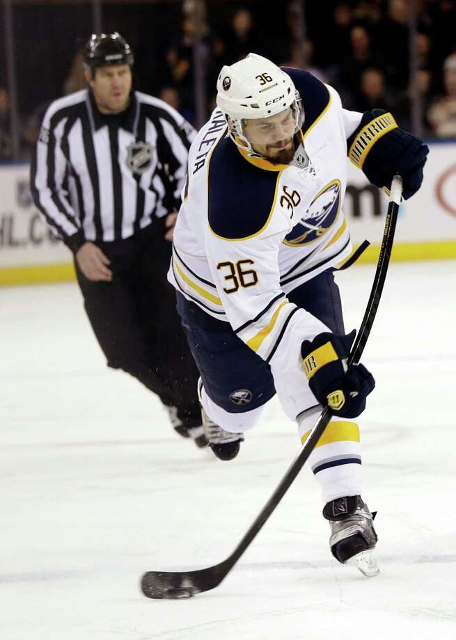 Buffalo Sabres' Patrick Kaleta takes a shot during the first period of their NHL hockey game against the New York Rangers in New York, Sunday, March 3, 2013. (AP Photo/Seth Wenig) Photo: Seth Wenig