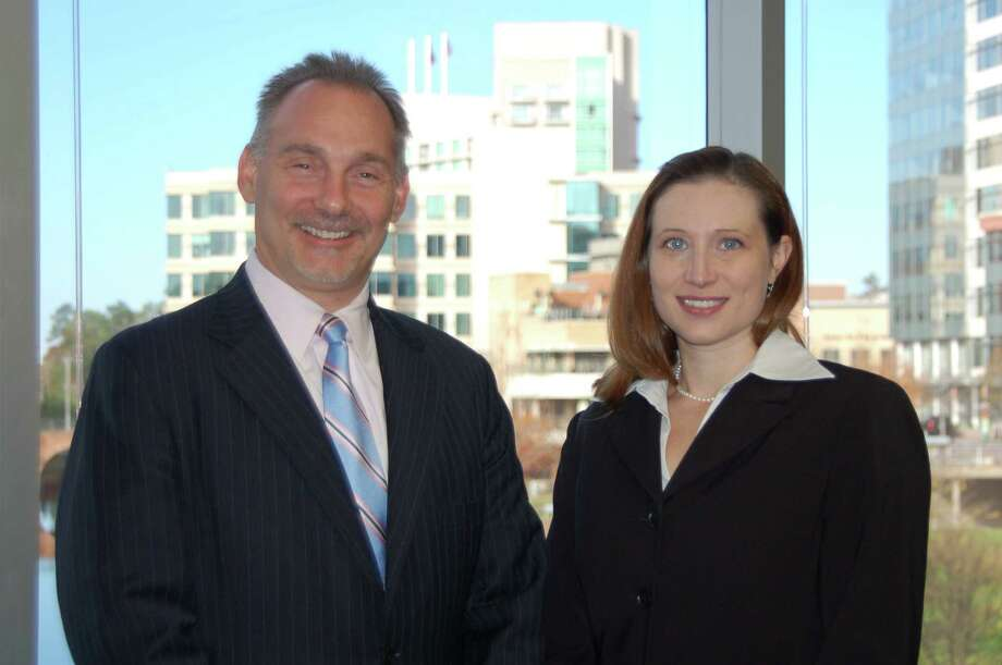 Bret Strong, left, founder and managing shareholder of The Strong Firm P.C., with Wendy Lambie, associate attorney.