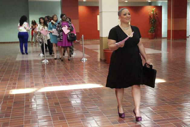 Ericka O'Bryant  is the first to audition for the 2013 Full Figured Fashion Week casting tour at Wonderland of the Americas mall on Sunday. Casting call winners will travel to New York in June to compete to become the face of next year's event. Photo: Jerry Lara / San Antonio Express-News