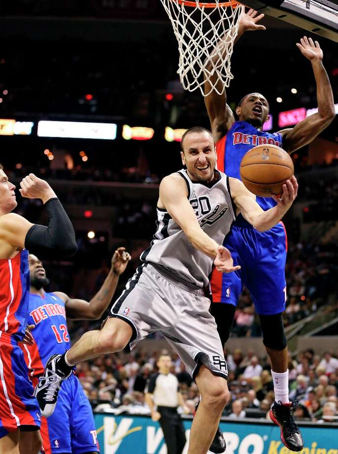 San Antonio Spurs' Manu Ginobili passes between Detroit Pistons' Jonas Jerebko (from left), Detroit Pistons' Will Bynum and Detroit Pistons' Brandon Knight during second half action Sunday March 3, 2013 at the AT&T Center. The Spurs won 114-75. Photo: Edward A. Ornelas, San Antonio Express-News / © 2013 San Antonio Express-News
