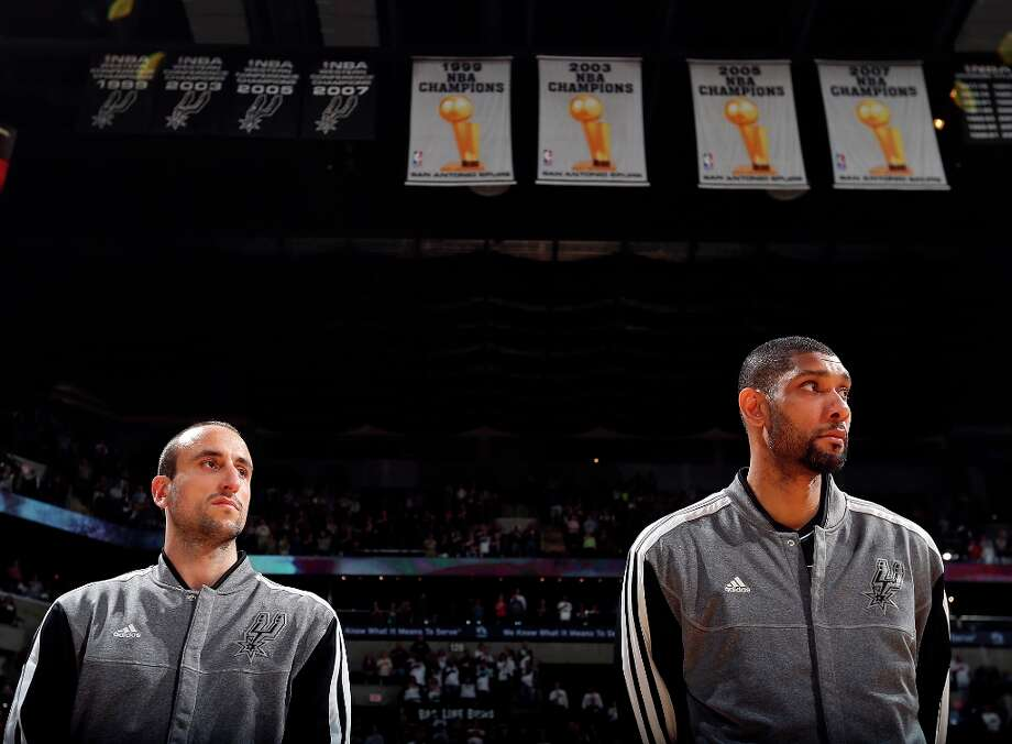 San Antonio Spurs' Manu Ginobili (left) and San Antonio Spurs' Tim Duncan stand during the national anthem before the game with the Detroit Pistons Sunday March 3, 2013 at the AT&T Center. Photo: Edward A. Ornelas, San Antonio Express-News / © 2013 San Antonio Express-News