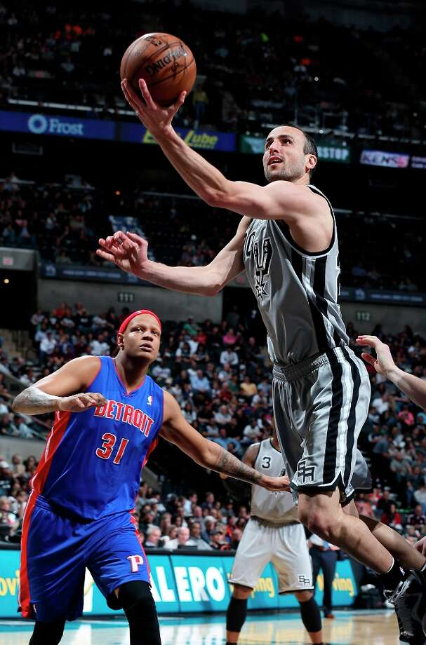 The Spurs' Manu Ginobili shoots around Detroit Pistons' Charlie Villanueva during first half action Sunday, March 3, 2013 at the AT&T Center. Photo: Edward A. Ornelas, San Antonio Express-News / © 2013 San Antonio Express-News