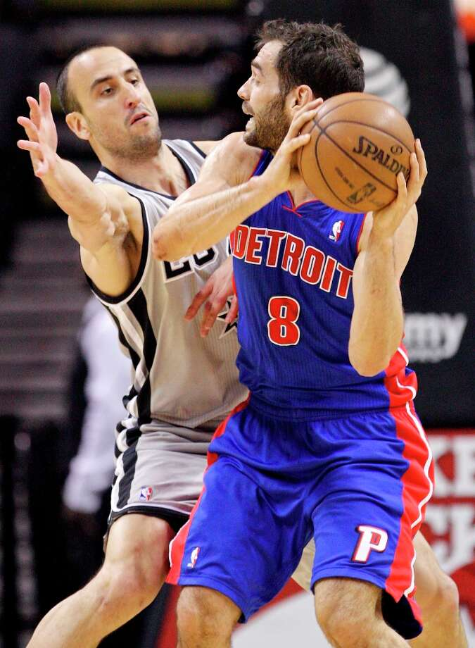 The Spurs' Manu Ginobili defends Detroit Pistons' Jose Calderon during first half action Sunday, March 3, 2013 at the AT&T Center. Photo: Edward A. Ornelas, San Antonio Express-News / © 2013 San Antonio Express-News