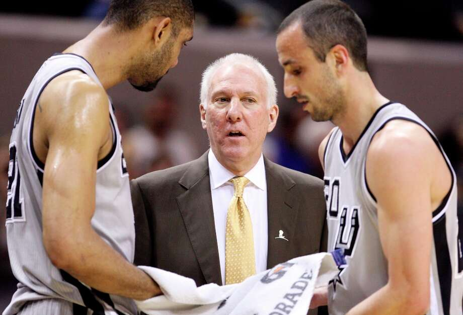 Spurs coach Gregg Popovich (center) talks with the Spurs' Tim Duncan and Manu Ginobili during a timeout in first half action Sunday, March 3, 2013 at the AT&T Center. Photo: Edward A. Ornelas, San Antonio Express-News / © 2013 San Antonio Express-News