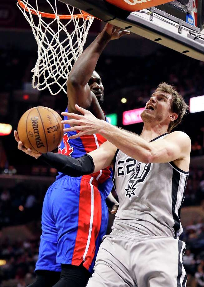 The Spurs' Tiago Splitter shoots around Detroit Pistons' Jason Maxiell during second half action Sunday, March 3, 2013 at the AT&T Center. The Spurs won 114-75. Photo: Edward A. Ornelas, San Antonio Express-News / © 2013 San Antonio Express-News
