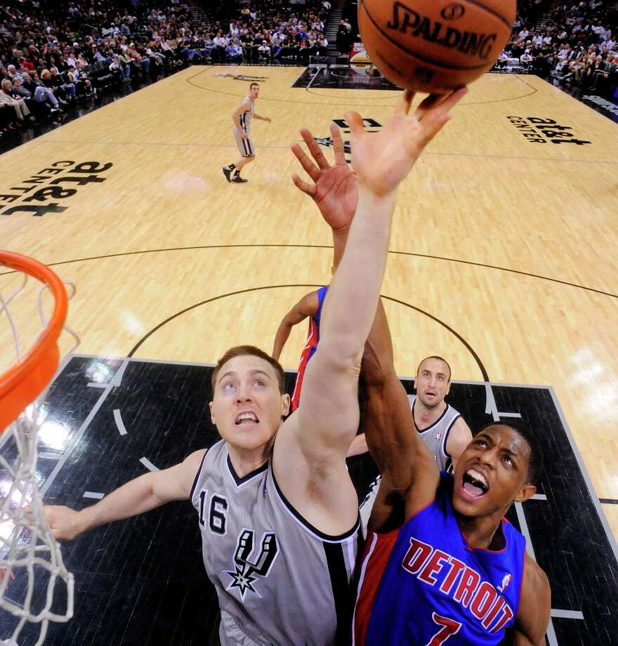 The Spurs' Aron Baynes and Detroit Pistons' Brandon Knight grab for a rebound during second half action Sunday, March 3, 2013 at the AT&T Center. The Spurs won 114-75. Photo: Edward A. Ornelas, San Antonio Express-News / © 2013 San Antonio Express-News