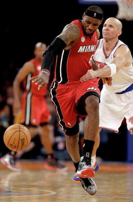 The Knicks' Jason Kidd resorts to fouling to try to slow down LeBron James. Photo: Kathy Willens, STF / AP