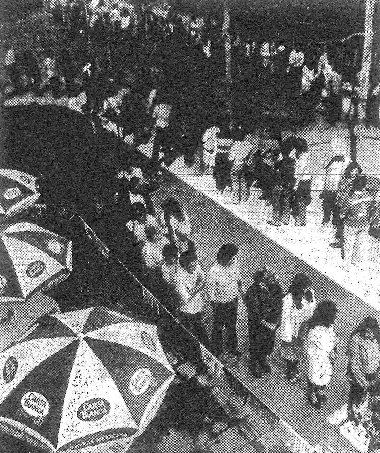 Hundreds of job hunters line up at El Mercado for interviews with St. Anthony Hotel officials. More than 5,000 applications are expected for 400 jobs. Published in the San Antonio Light March 2, 1983. Photo: File Photo
