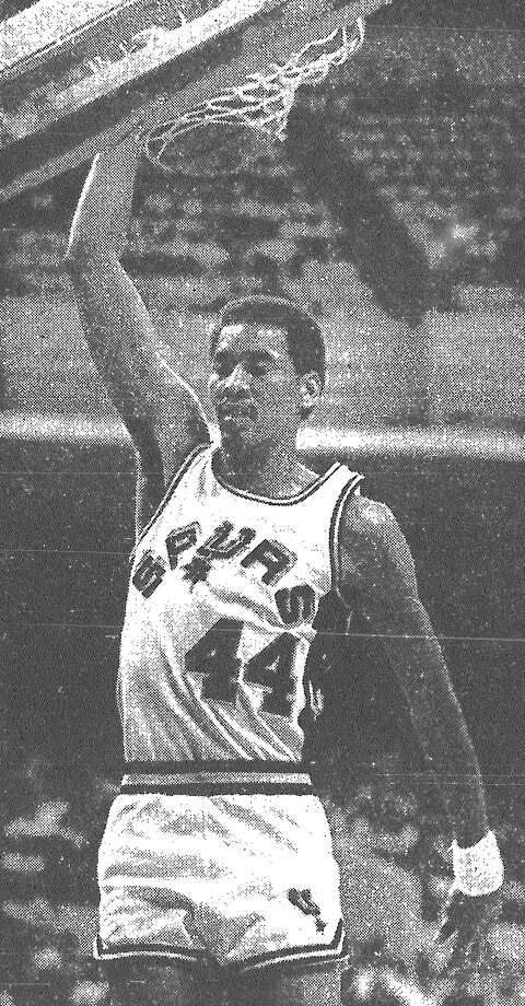 George Gervin puts one in for the Spurs during the team's 119-104 win over the Sonics. Published in the San Antonio Express March 2, 1983. Photo: File Photo