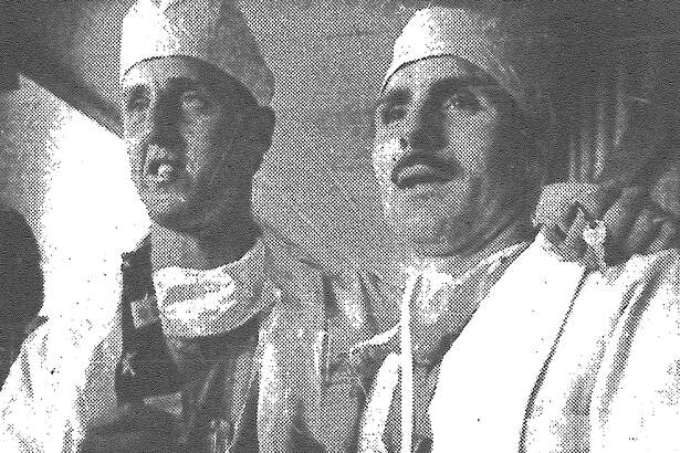"""Among the M*A*S*H addicts who crowded Doc Holiday to bid adieu to the 11-year-old series Monday night were Mike Mokri and Joe Potoky. Droves of San Antonians dressed in Army fatigues, surgeon's garb and spinoffs from the """"Klinger collection"""" packed in to watch the 2½-hour finale that ended television's re-creation of the Korean War and sent the 4077th Mobile Army Surgical Hospital packing for home. The goodbye festivities at the nightclub included a M*A*S*H character look alike contest and an auction of show memorabilia, such as a director's chair signed by Gary Burghoff. Published in the San Antonio Express March 1, 1983."""