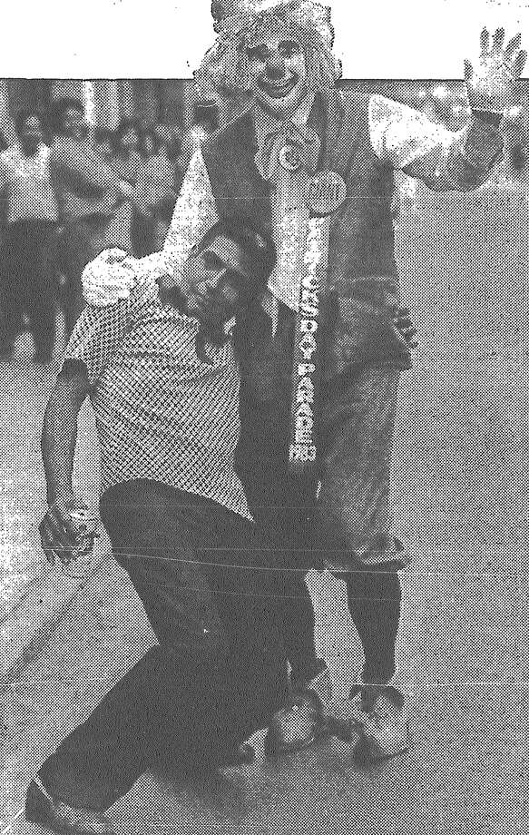 Joe Rubio gets in the spirit with clown Ed Tuma during the St. Patrick's Day Parade. Published in the San Antonio Express March 13, 1983. Photo: File Photo