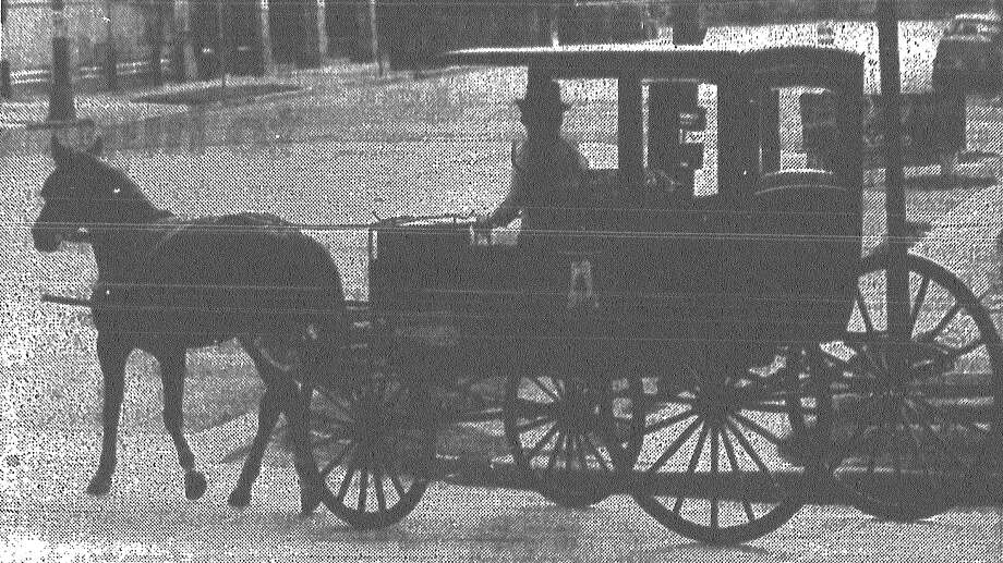"Horse-drawn carriages like this one have won the San Antonio City Council's approval to trot down San Antonio streets, but now their drivers must mind a curfew, follow a dress code and to prevent health and sanitation problems, horses must wear ""diapers"" to collect waste during their journeys. The proposal asking for two-year permits for the operation of the carriages received almost unanimous support from council members. The only dissenting vote came from Councilman Van Archer, who still believes the carriages ""are nothing but apple crates that block traffic and cause a danger to us all."" Published in the San Antonio News March 11, 1983. Photo: File Photo"