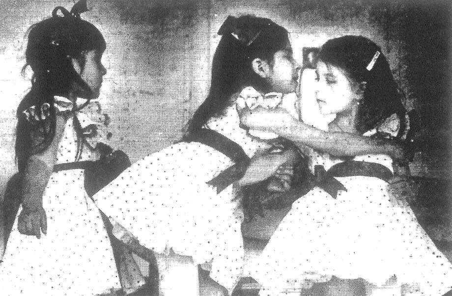 "San Antonio Parks and Recreation dancers Liza Lozano (left) and Maria Isabel Rodriguez (center) help Zulema Rodriguez turn the right way during their performance yesterday. They danced in the ""It's Clear Sailing for Woodlawn Lake"" celebration. Published in the San Antonio Light March 7, 1983. Photo: File Photo"