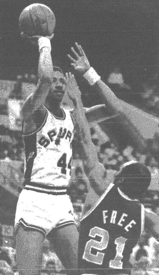 The Spurs' George Gervin shoots over the Cavaliers' World B. Free. Gervin had 20 points in the Spurs' 117-98 win over Cleveland. Published in the San Antonio Express March 7, 1983. Photo: File Photo