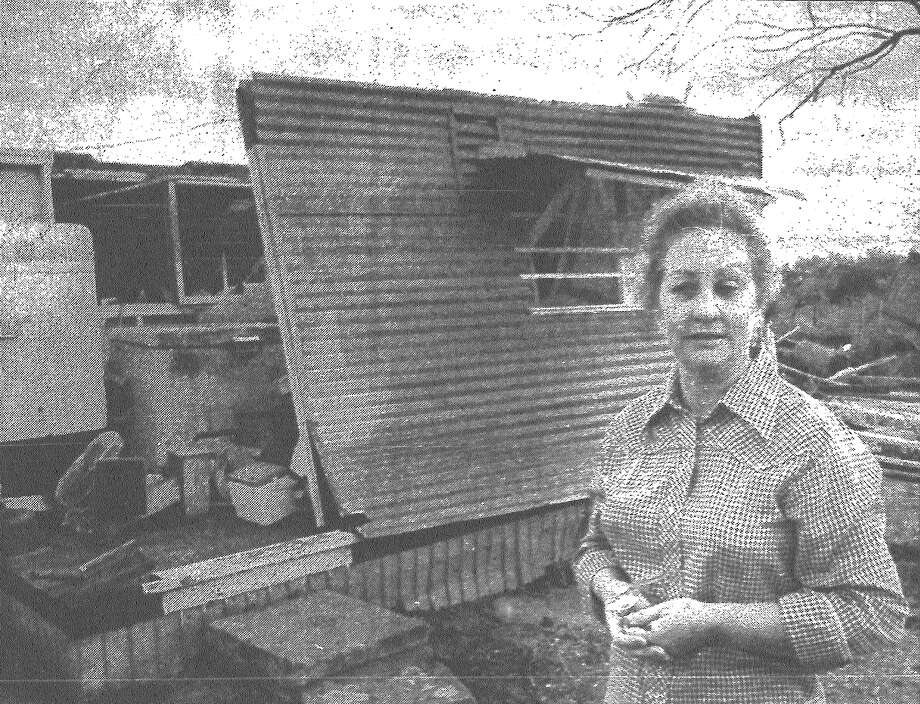 "Patsy Parrish flattened herself in this tin storehouse on her property seven miles north of Boerne near Wasp Creek when she saw a tornado bearing down on her. When it was over, she looked up and the roof was gone. She wasn't injured, but she said with a sigh, ""It took my shoes off."" Published in the San Antonio Express March 5, 1983. Photo: File Photo"