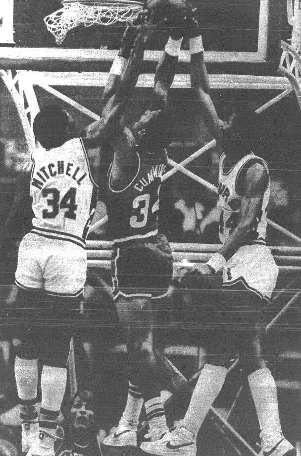 The Spurs' Mike Mitchell and George Gervin battle the San Diego Clippers' Terry Cummings for a rebound. The Spurs won, 130-109. Published in the San Antonio News March 16, 1983. Photo: File Photo