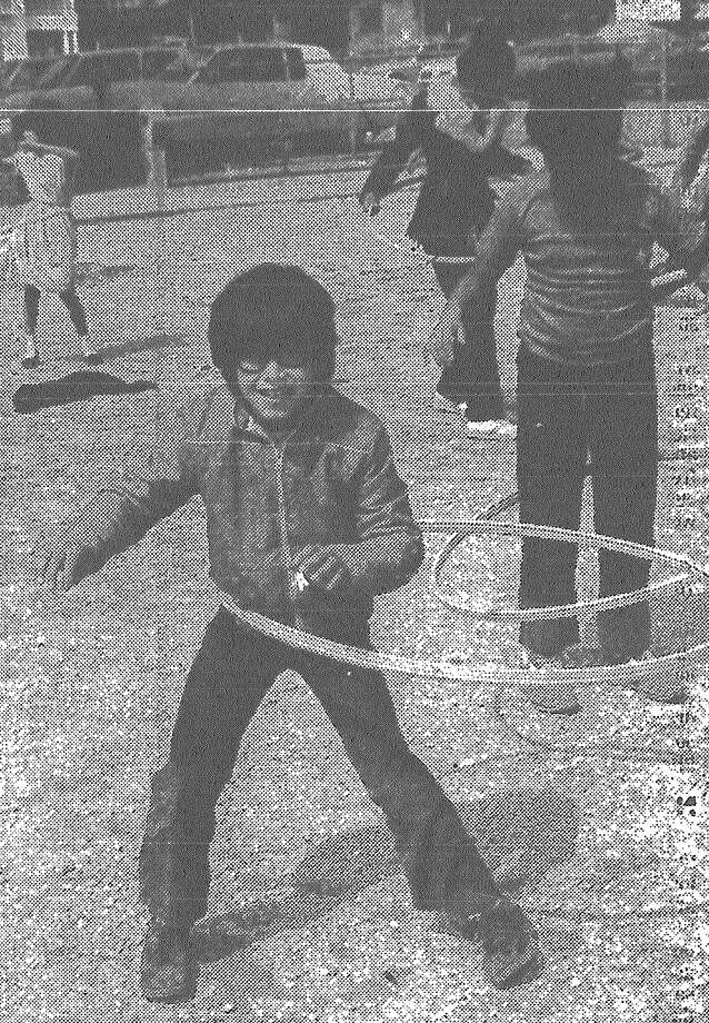 Jose Villarreal hula-hoops with his Travis Elementary schoolmates, showing physical education can be fun while promoting fitness. Published in the San Antonio Express March 22, 1983. Photo: File Photo