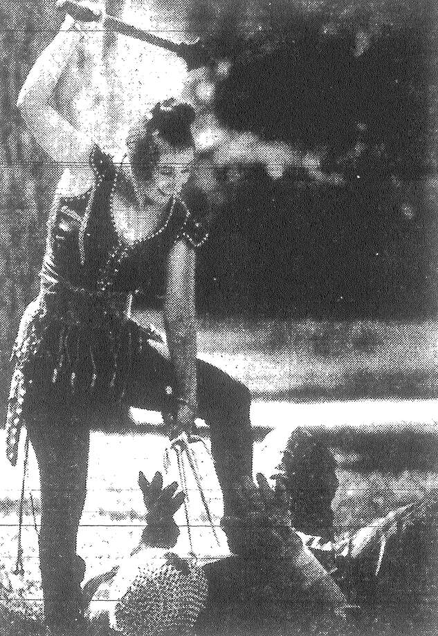 Karen Freeman practices battle techniques on Rodney Holmes during a Witte Museum demonstration of warfare from medieval times through more recent Western civilization. Published in the San Antonio Light March 21, 1983. Photo: File Photo
