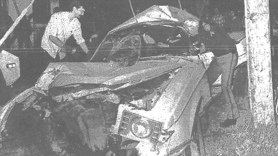 San Antonio police inspect the twisted car in which one man was killed after a high-speed chase Saturday. The car sliced through a utility pole at an estimated 100 mph, plunging a South Side neighborhood into darkness for several hours. Published in the San Antonio Express March 20, 1983. Photo: File Photo