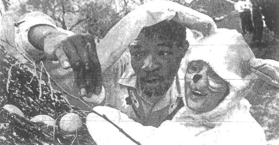 Edy Hernandez, the Easter rabbit, and Francis Datsun find a hidden treasure during yesterday's Gigantic Easter Egg Hunt at the San Antonio State Hospital. Published in the San Antonio Light March 30, 1983. Photo: File Photo