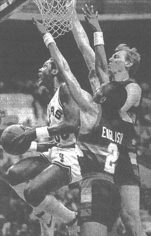 Johnny Moore of the Spurs tries to avoid the Nuggets' Alex English and Dan Issel during the Spurs' 136-129 win over Denver, virtually clinching a third-straight Midwest Division title for the Spurs. Published in the San Antonio Express March 30, 1983. Photo: File Photo