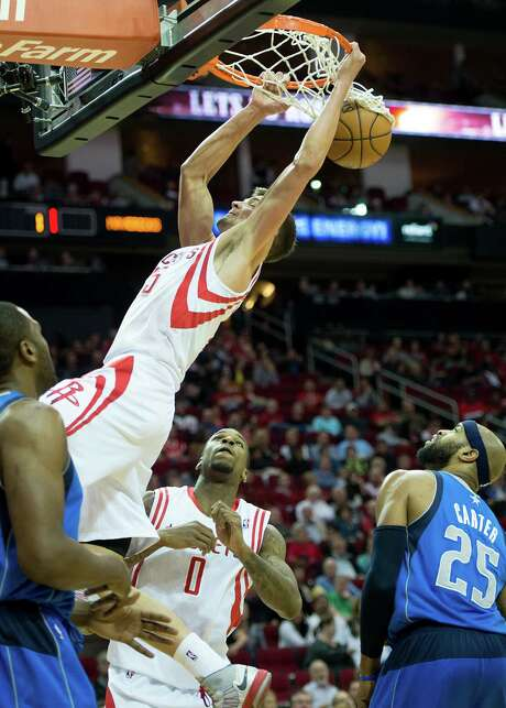 Chandler Parsons was effective from near and far Sunday, putting home this high-percentage shot to help his 12-for-13 shooting night that included six 3-pointers. Photo: Smiley N. Pool, Staff / © 2013  Houston Chronicle