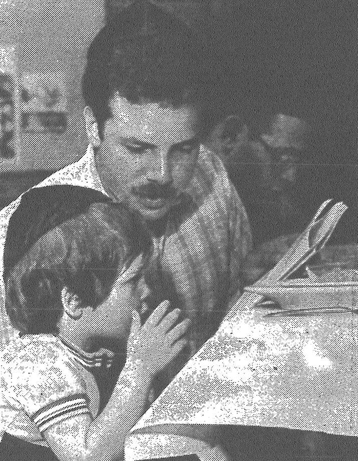 Benjamin Moses, 3½, learns a Passover lesson from his father, Army Spec. 4 Jonas Moses during the Passover Seder for military personnel Monday night at the Jewish Community Center. Published in the San Antonio News March 29, 1983. Photo: File Photo